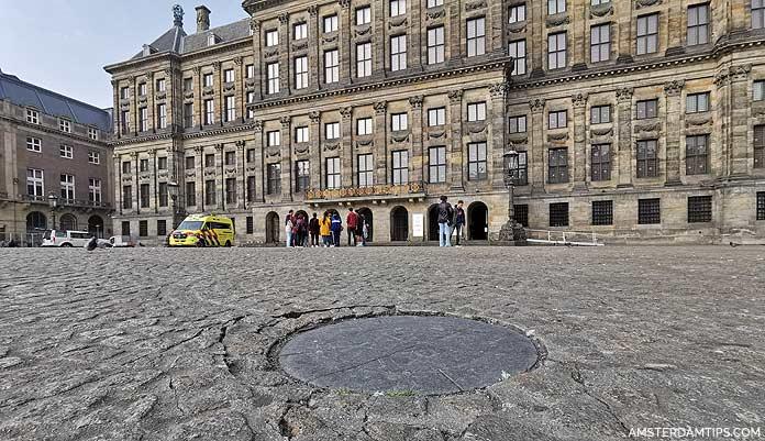 dam square amsterdam nap stone